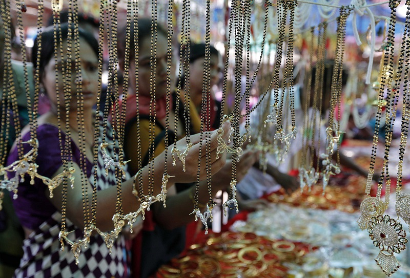 Women buy artificial jewellery at an open air market ahead of the Hindu festival of Diwali in Ahmedabad