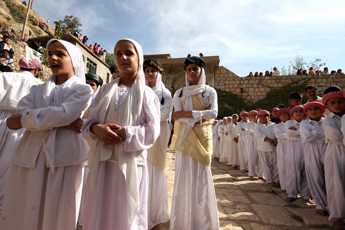 Yazidi children at their holiest site, Lalish Temple